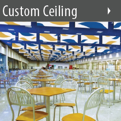 Audimute's Ceiling Baffles can be customized with your logo or an image of your choice, shown here in a grouping above a cafeteria.